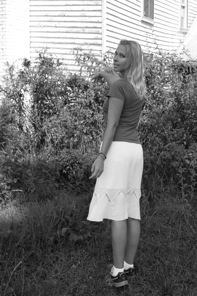 IMG_1482 tommie by the rose bush c..jpg